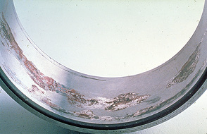 Fretting corrosion is visible in the bore of an inner ring.